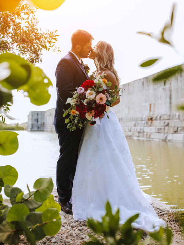 Photo of a groom and bride kissing at Fort Zachary Taylor.