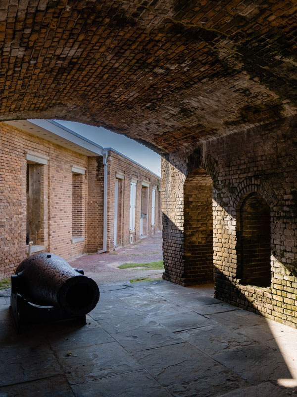 Photo of a cannon and an archway at Fort Taylor.